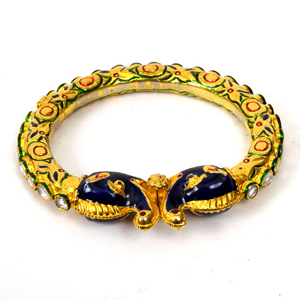 brass. Nowadays, precious stones are set and are enameled with gold
